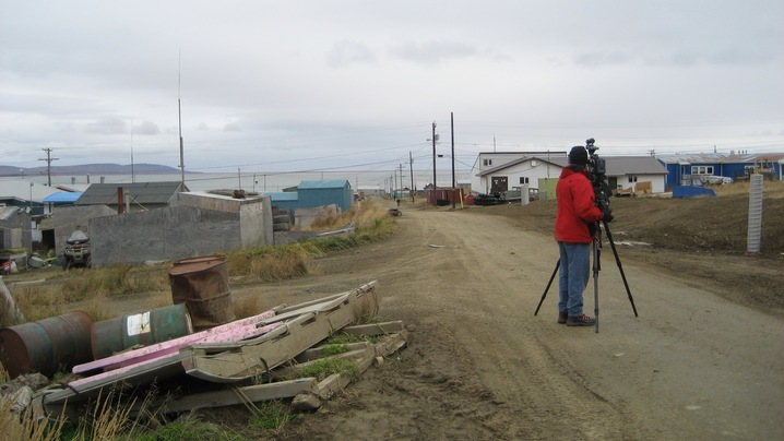 Veteran NewsHour Cameraman Brian Gill takes a parting shot of Toksook Bay. Photo by Sarah Clune, courtesy of PBS.